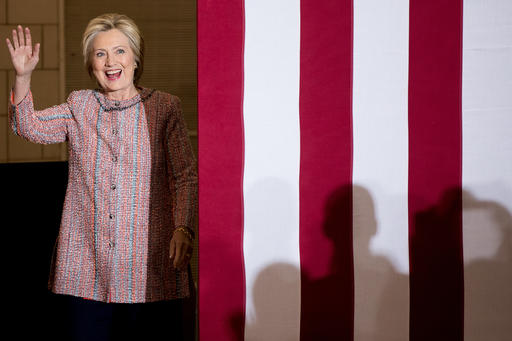 Democratic presidential candidate Hillary Clinton waves as she arrives at a rally at University of North Carolina, in Greensboro, N.C., Thursday, Sept. 15, 2016. Clinton returned to the campaign trail after a bout of pneumonia that sidelined her for three days and revived questions about both Donald Trump's and her openness regarding their health. (AP Photo/Andrew Harnik)