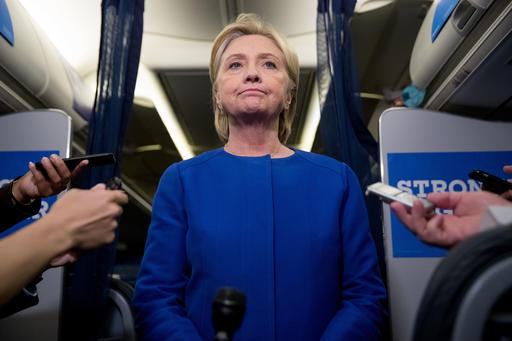 Democratic presidential candidate Hillary Clinton pauses while she gives remarks on the explosion in Manhattan's Chelsea neighborhood onboard her campaign plane at Westchester County Airport, in White Plains, N.Y., Saturday, Sept. 17, 2016. (AP Photo/Andrew Harnik)