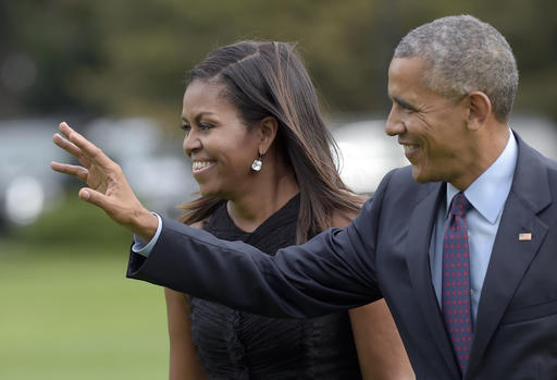 President Barack Obama, with first lady Michelle Obama, waves as they walk from Marine One on the South Lawn of the White House in Washington, Wednesday, Sept. 21, 2016. The Obama's were returning from New York where the president addressed the United Nations General Assembly for his final time as president. (AP Photo/Susan Walsh)