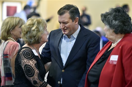"""Sen. Ted Cruz, R-Texas, center, talks with Cathie Adams, past president of Texas Eagle Forum, at the annual Grassroots America We The People Champions of Freedom award dinner Friday, Sept. 23, 2016 in Tyler, Texas. Ted Cruz announced Friday he will vote for Donald Trump, a dramatic about-face that may help unite a deeply divided Republican Party months after the fiery Texas conservative called Trump a """"pathological liar"""" and """"utterly amoral."""" (Andrew D. Brosig/Tyler Morning Telegraph via AP)"""
