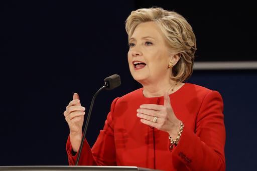 In this Sept. 26, 2016, photo, Democratic presidential candidate Hillary Clinton answers a question during the presidential debate with Republican presidential candidate Donald Trump at Hofstra University in Hempstead, N.Y. Clinton has vowed to respond to foreign hacking the same as any other attack against the United States. She's openly blamed Russia for recent U.S. cyber break-ins while Donald Trump wondered if overseas governments or overweight hackers at home were responsible. (AP Photo/David Goldman)