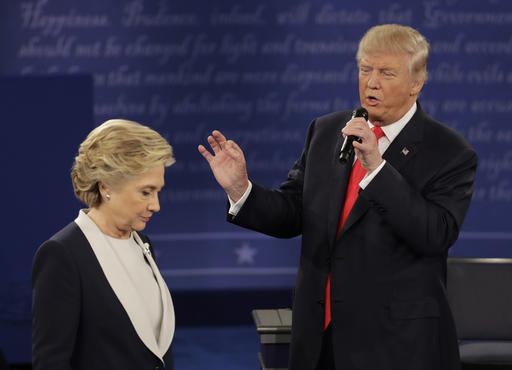 Democratic presidential nominee Hillary Clinton walks past Republican presidential nominee Donald Trump during the second presidential debate at Washington University in St. Louis, Sunday, Oct. 9, 2016. (AP Photo/Patrick Semansky)