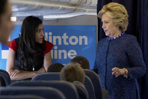 Democratic presidential candidate Hillary Clinton speaks with senior aide Huma Abedin aboard her campaign plane at Westchester County Airport in White Plains, N.Y., Friday, Oct. 28, 2016, before traveling to Iowa for rallies. (AP Photo/Andrew Harnik)