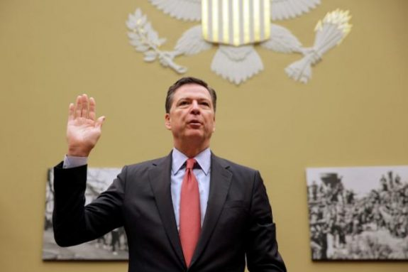 "FBI Director James Comey is sworn in before testifying before a House Judiciary Committee hearing on ""Oversight of the Federal Bureau of Investigation"" on Capitol Hill in Washington, U.S., September 28, 2016. REUTERS/Joshua Roberts"