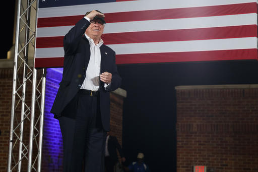 Republican presidential candidate Donald Trump looks at the crowd as he arrives to a campaign rally, Wednesday, Nov. 2, 2016, in Pensacola, Fla. (AP Photo/ Evan Vucci)