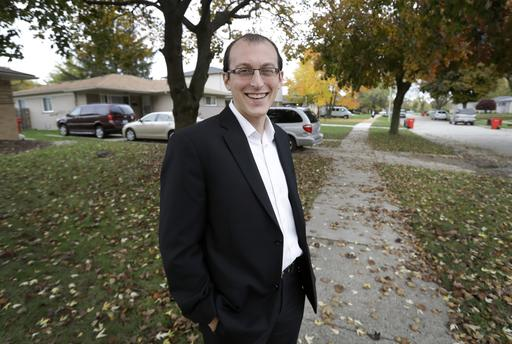 In this photo taken Nov. 3, 2016, Moshe Sherizen, an undecided voter, is shown outside his home in Southfield, Mich. After all the sound, fury, fact, fallacy, bluster and blarney of the 2016 presidential campaign, there still are undecided voters out there. Really. And they're not just people who've buried their heads in the sand. Some thoughtful people just do not know what to do with the choices they've been given, yet are determined to exercise their right to vote. (AP Photo/Carlos Osorio)