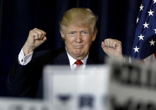 Republican presidential candidate Donald Trump pumps his fists as he takes the stage during a campaign rally Saturday, Nov. 5, 2016, in Tampa, Fla. (AP Photo/Chris O'Meara)