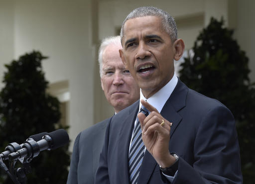President Barack Obama, accompanied by Vice President Joe Biden, speaks about the election results, Wednesday, Nov. 9, 2016, in the Rose Garden at the White House in Washington. (AP Photo/Susan Walsh)