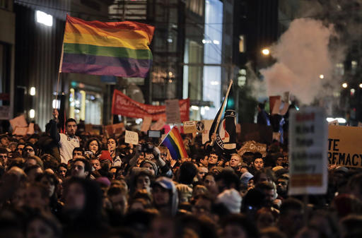 Protesters demonstrate on Fifth Avenue outside Trump Tower, Wednesday, Nov. 9, 2016, in New York, in opposition of Donald Trump's presidential election victory. (AP Photo/Julie Jacobson)