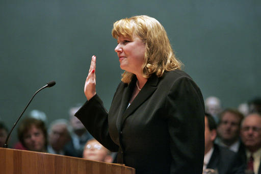 FILE - In this March 13, 2006, file photo, Allison Eid is sworn in as chief justice of the Colorado Supreme Court in Denver. Two Supreme Court justices and nine judges on President-elect Donald Trump's list of potential high court picks are among more than 1,000 people expected at a gathering of conservative lawyers that has suddenly turned into an impromptu job fair for spots in the new administration. The Federalist Society's national lawyers' convention begins Nov. 17 in Washington as a tribute to the late Justice Antonin Scalia, an early supporter of the group and a hero to many of its 40,000 members.  (AP Photo/Linda McConnell, Pool)