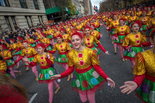 FILE - In this Thursday, Nov. 26, 2015, file photo, Dancers move down Central Park West during the Macy's Thanksgiving Day Parade in New York. A giant Charlie Brown balloon will join 1,000 clowns and a dozen marching bands along a parade route lined with spectators and police in plainclothes for the 90th annual parade. (AP Photo/Bryan R. Smith, File)