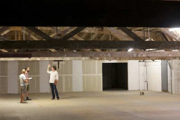 Everard, right, shows off the space about to be overhauled from the sidewalk to the rafters (Images: CHS)