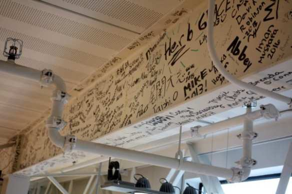 Students spent part of their time Monday trying to find their signatures on the buildings rafters