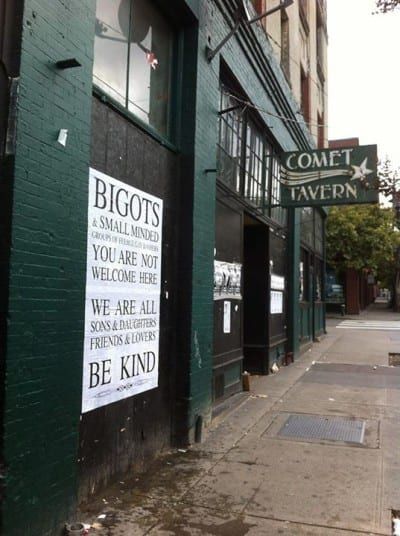"""Hate crimes are on the neighborhood's mind -- Sign says """"BIGOTS & SMALL MINDED Groups of FEEBLE gay bashers"""" not welcom"""