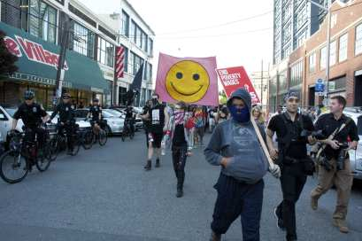 """Protesters from the """"Anticapitalist March"""" got an early jump on East Precinct but barricades were erected just in time to divert the rally south on 11th (Image: CHS)"""