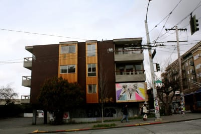 Above, the new Three20 building -- below, the old Marion Apartments (Images: King County, CHS)