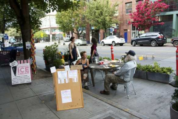 """The creator of the """"Community Conversations"""" pop-up park on E Pike said she had an ulterior motive for participating in Park(ing) Day 2014 -- she's new in town and looking to make friends! Stop by! (Image: CHS)"""