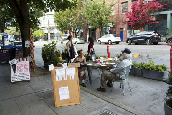"The creator of the ""Community Conversations"" pop-up park on E Pike said she had an ulterior motive for participating in Park(ing) Day 2014 -- she's new in town and looking to make friends! Stop by! (Image: CHS)"