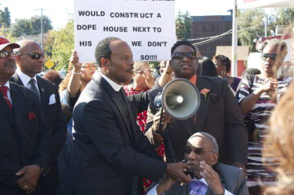 Pastor Witherspoon assists Mt Zion's Reverend Samuel B. McKinney with the bullhorn at a rally against Uncle Ike's in October (Image: CHS)