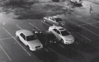 Police are looking for information on this white Crown Victoria-style car seen here in a surveillance video image recorded during a robbery near Seattle U in November