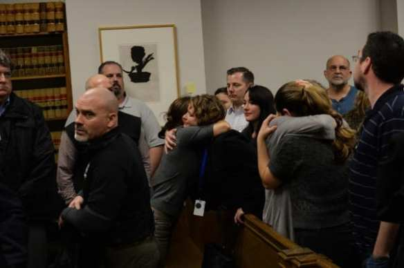 Noll's friends and family embrace after guilty verdict was read (Photo: Tim Durkan)