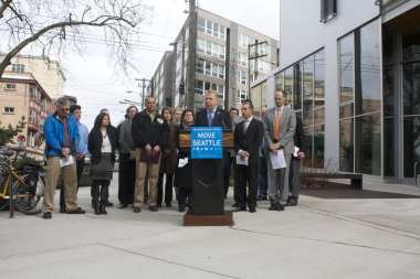 Mayor Murray announces the new levy proposal in the shadow of the Bullitt Center alongside a busy E Madison (Image: CHS)