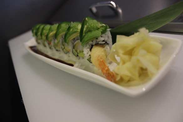 TheGreen Lake Monster with tempura jumbo shrimp and bamboo leaves has a special plating technique (Image: Agazit Afeworki)