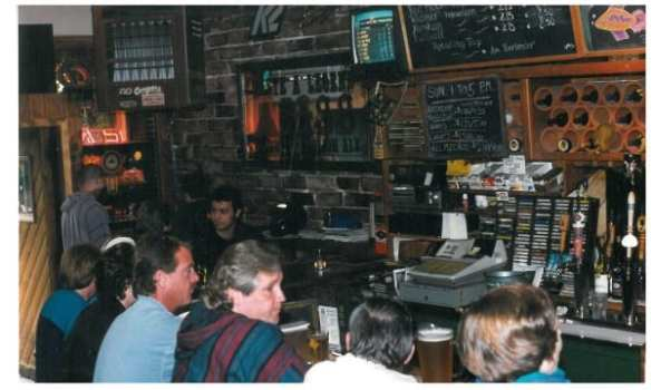 """Chris Price shared this, """"the oldest photo I can put my hands on right now - most likely from the late 90's, possibly 2000, since it's pre-liquor. Note the cassette tape rack! And the tall blond guy in the middle is Greg, the regular most everyone would recognize. He died in 2013 and there is a little plaque marking his spot at the bar..."""" (Image: The Roanoke with permission to CHS)"""