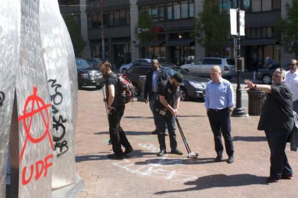 Mayor Murray surveys the graffiti at Seattle Central as members of the Love is Not Lost group worked to clean up some of Friday night's remaining mess (Image: CHS)