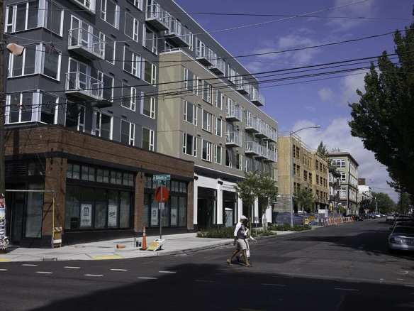 West side 11th from Union. Broadstone Infinity on left, then Modera. Historic Lorraine Apartments on corner at Pike.
