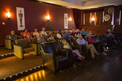 The folks at Aegis Living on Madison catch a movie in the facility's theater (Image: Aegis Living)