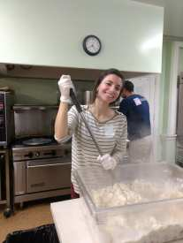 Tina mashing a lot of potatoes