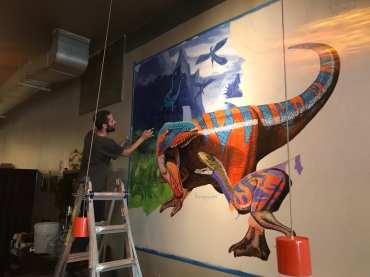 Artist Craig Cundiff painting the mural that was unveiled on Sunday, July 29. Photo courtesy: Michael Lee.