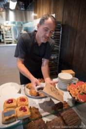 Scott France, co-owner of Macrina, bags a slice of banana walnut bread.