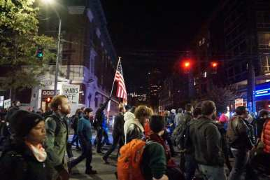 Flags were a common sight Thursday night as the march made its way off the Hill (Images: CHS)