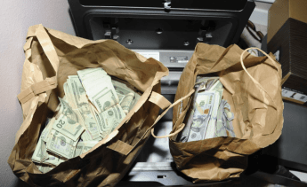Some of the thousands in cash seized by authorities in the case
