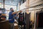 Chris Bosquez hangs clothing as Doghouse Leathers opens in its new location.