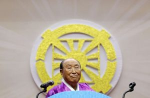 Evangelist Reverend Moon reacts as he delivers a speech in Gapyeong