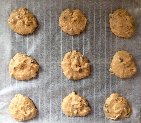 Drop a large (heaped) tablespoon of cookie dough onto the baking paper.