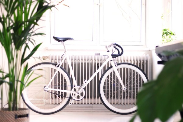 bicycle by radiator in hall: home tips to save energy