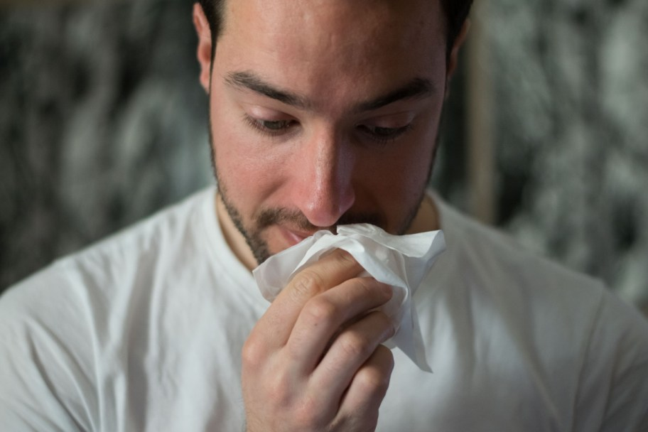 sneeze cold allergy man ill
