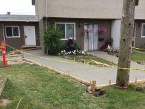Concrete sidewalk repair for rental building in Chilliwack, BC.