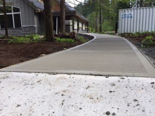 Broomed concrete sidewalk at Stillwood Camp