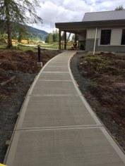 Curved concrete sidewalk at Stillwood Camp