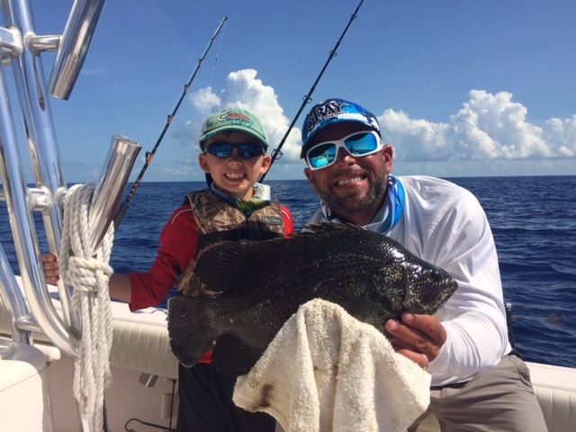 Isiah with his first tripletail with Capt. Doug off Marathon in the Fl Keys.