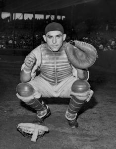 Yogi is perhaps best known for his hitting exploits, but he his defense was also a big contributor to the Yankees' success. (Photo: SportingNews)