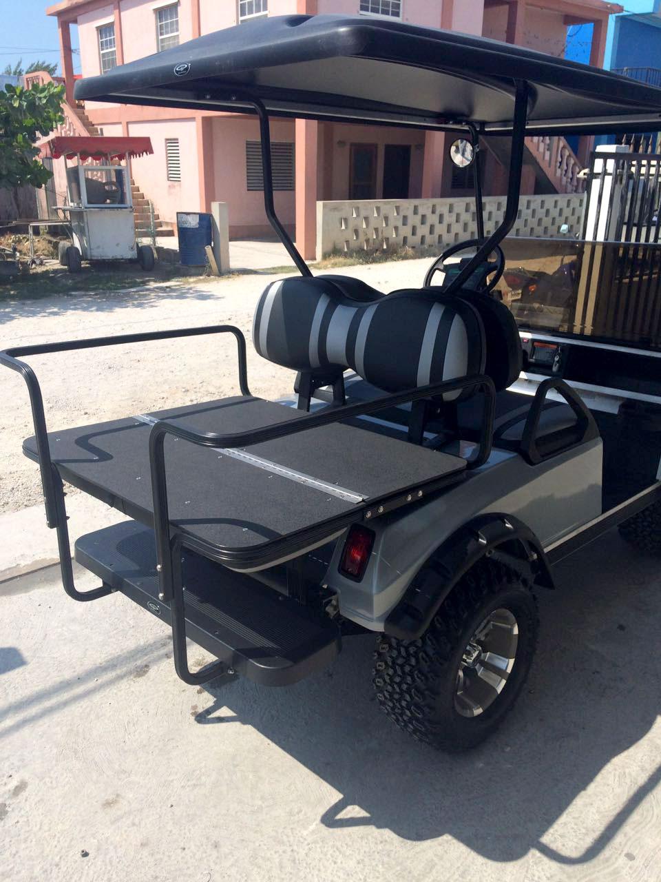 medium resolution of grey villager golf cart with fold back seat