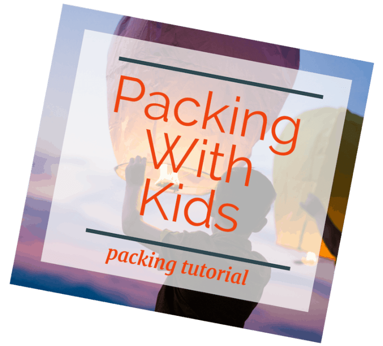 image of child with releasing paper lantern at sunset with text overlay Packing with Kids: Packing Tutorial.