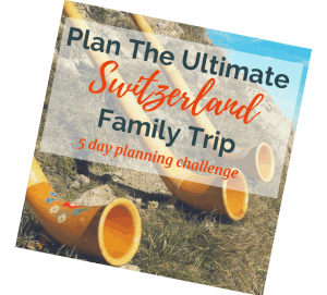 "Image of Swiss Folk instrument (horn) on mountains overlooking lakes in summertime with text overlay ""Plan your ultimate Switzerland trip. 5 day challenge"