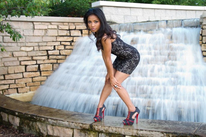 model, waterfall, black dress, heels